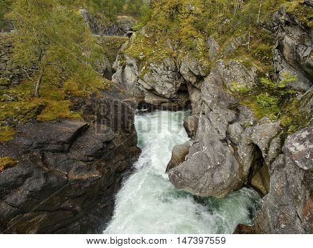 The mountain river Jostedola, originating from a thawing glacier, Norway