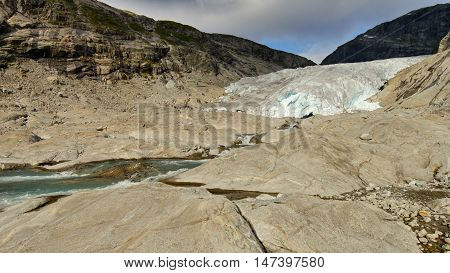 Glacier Nigardsbreen, Norway. The river flowing from glacier
