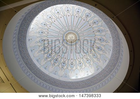Kuala Lumpur, Malaysia - November 30, 2015. Inner dome of the Islamic Arts Museum in Kuala Lumpur, with ornaments.