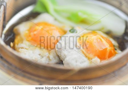 dim sum or steam egg in the basket
