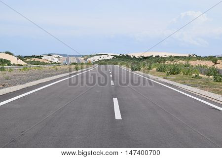 open asphalt highway road with blue sky