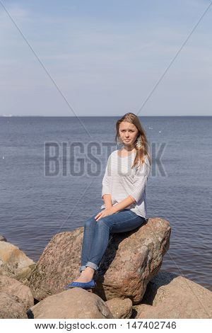 Portrait of a girl on the rocks