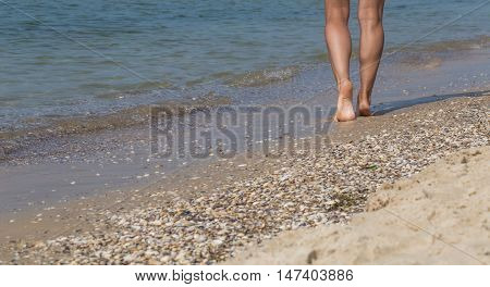 Sexy Legs On The Beach. Walking Female Feet