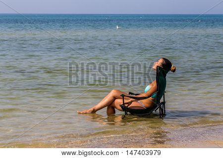 Beautiful Girl Sits Alone In The Sea,  Nice Tan