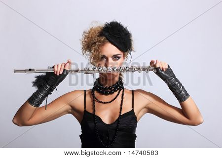 Portrait of a fashion woman with transverse flute
