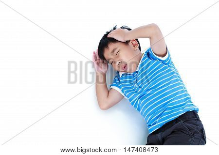 Top view child lie down. Asian boy have a headache his hand on head emotion feeling sign. Isolated on white background. Negative human emotion facial expression feeling reaction. Studio shot.