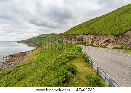 travel and countryside concept - asphalt road at wild atlantic way at connemara in ireland