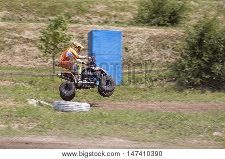 Dnepropetrovsk, Ukraine, May 22, 2016.Ukraine Motocross Championship in 2016. Racer while jumping a quad bike.