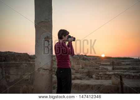 Photographing ruins at sunset Paphos Archaeological Park Republic of Cyprus