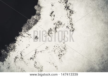 deliquescent ink blot on a white background