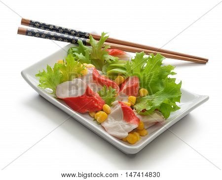 Crab meat with fresh green lettuce and corn's seeds on the plate