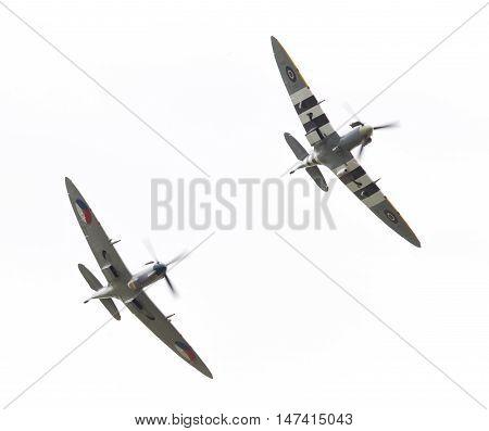 Leeuwarden, The Netherlands - June 10, 2016: Vintage Spitfire Fighter Planes Making A Low Flypast Fo