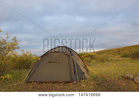 Tourist tent in the tundra. Summer in the Polar Ural Mountains.
