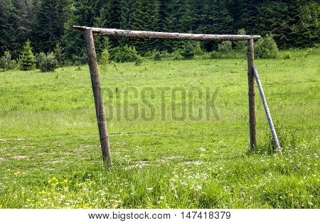 the primitive handmade wooden footbal goal at the mead