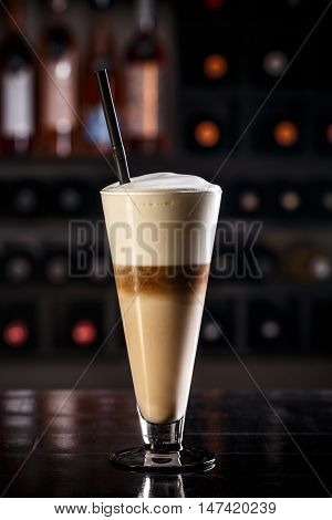 Latte macchiato with cream and chocolate, layered