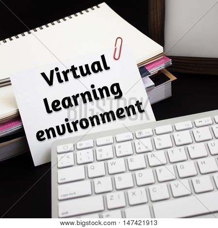 Word text Virtual learning environment on white paper card / business concept