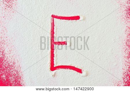 Letters of flour. Alphabet made of flour on the table. Letter E