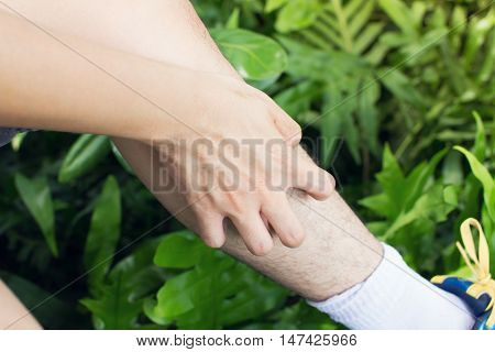 Man scratch the itch with hand Leg itching Concept with Healthcare And Medicine.