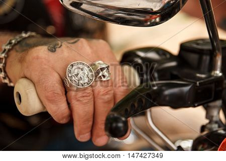 Hand biker on ore with silver rings