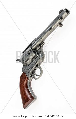 Old revolver on an isolated studio background