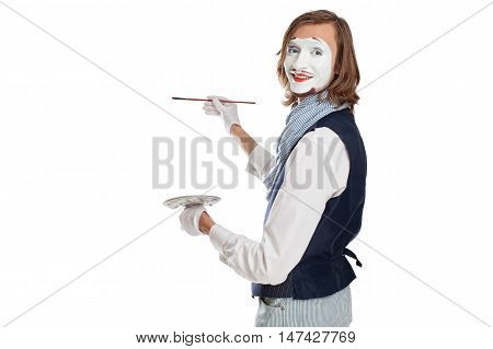 Mime Artist holding brush and easel and painting something