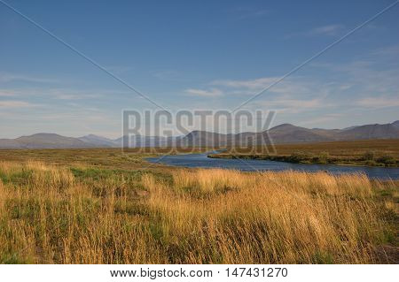 Scenic view of tundra and mountain river. Small Usa river, Polar Urals.