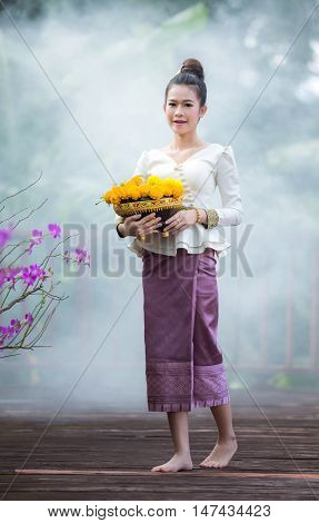 Lady in Laos holding flowers , Marigold