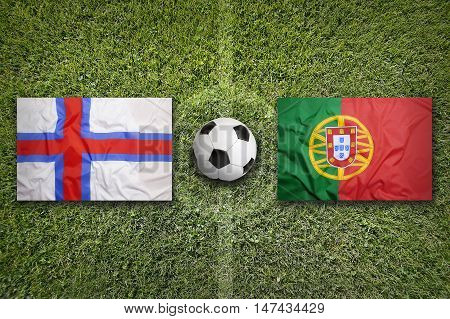 Faroe islands and Portugal flags on a green soccer field, 3D illustration