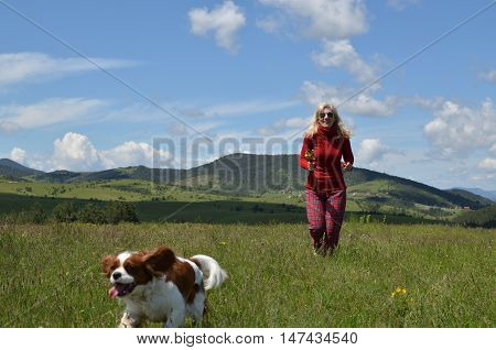 Joyful Woman And Dog Running In Countryside