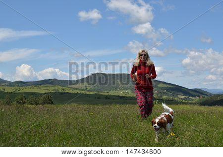 Happy Woman And Dog In A Countryside