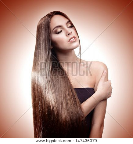 Beautiful young girl with long hair on color background. Beauty concept.
