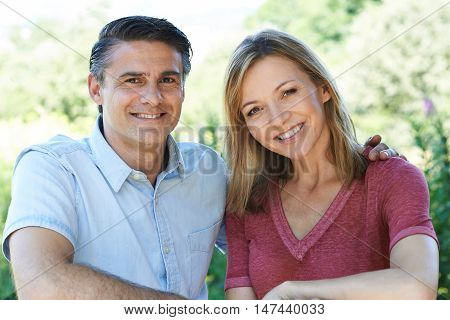 Outdoor Head And Shoulders Portrait Of Smiling Mature Couple