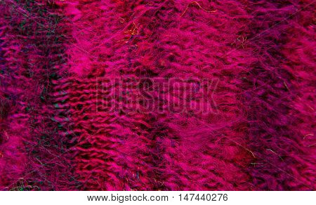 striped colorful wool texture handmade patten closeup macro red