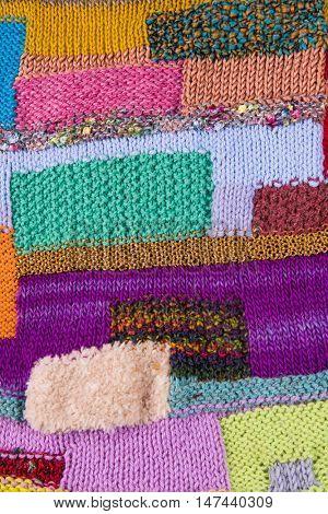 striped colorful wool texture handmade patten closeup macro blue red green yellow pink golden purple
