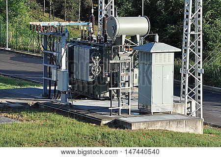 Modern big oil voltage transformer at the substation