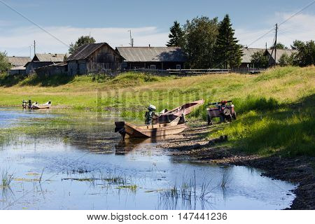 Rural Landscape With River, Handmade Boats And Houses