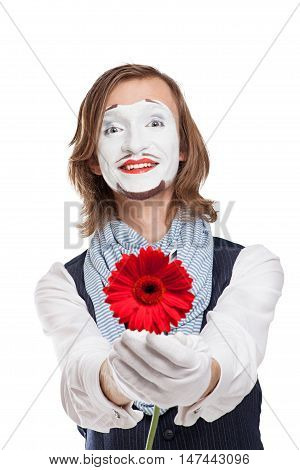 Mime Artist holds out red flower - Gerber