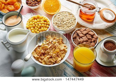 Breakfast healthy cereal coffee and orange juice and eggs