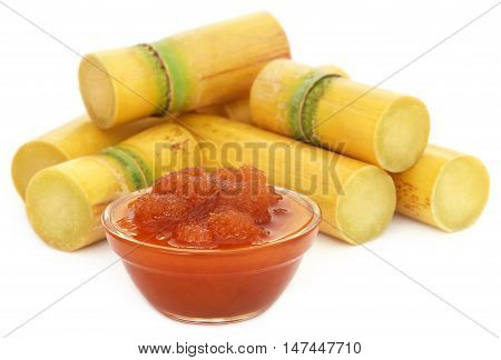 Close up of Molasses with sugarcane over white background