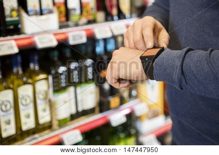 Customer Touching watch's Screen In Grocery Store