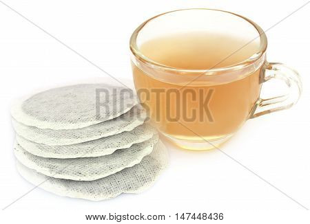 Green tea with teabag over white background