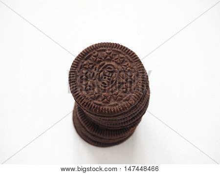 Novgorod, Russian Federation - September 5, 2016: A stack of fresh cream filled chocolate sandwich cookies. Selective focus on the top of the pile.