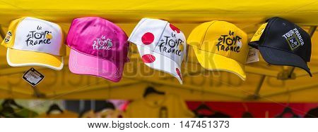 Col du Glandon France - July 23 2015: Image of promotional caps of Le Tour de France hanging at an Official Shop located on Col du Glandon in Alps during the stage 18 of Le Tour de France 2015.