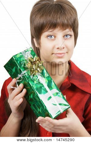 Portrait Of An Attractive Young Woman With A Gift