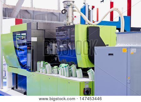 Industrial plastic injection moulding machine, color image, close up
