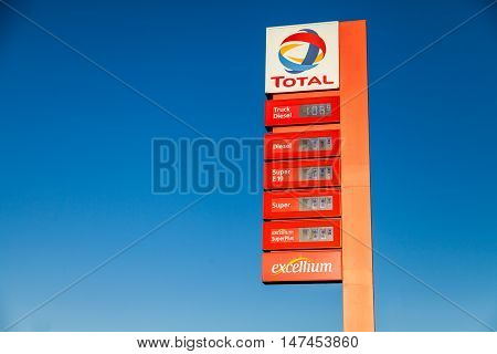 BURG / GERMANY - SEPTEMBER 15 2016: german gas station price sign from total stands on gas station