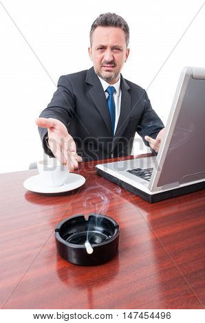Business Man Showing Cigarette On Ashtray At Office
