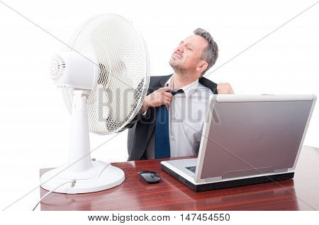 Business Man Pulling Tie In Front Of Ventilator