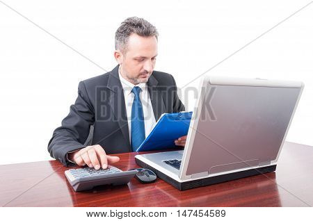 Man At Office Holding Clipboard And Calculating