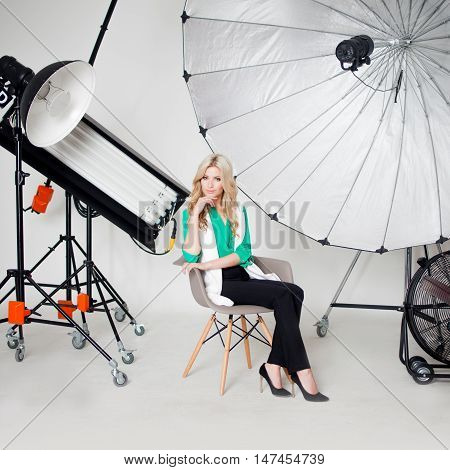 Young beautiful woman in Studio, lighting spotlights on background